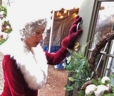 Mrs Claus opening door