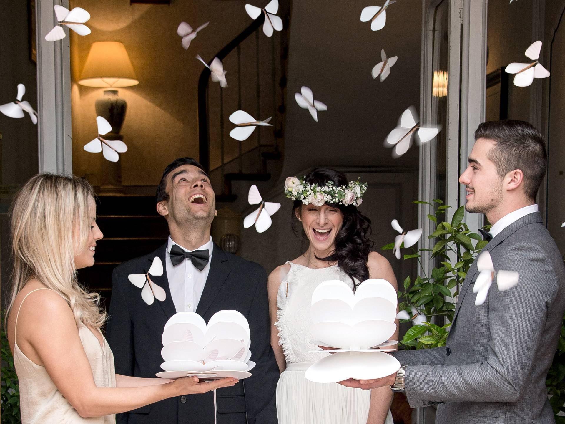 Happy wedding couple surrounded by flying butterflies